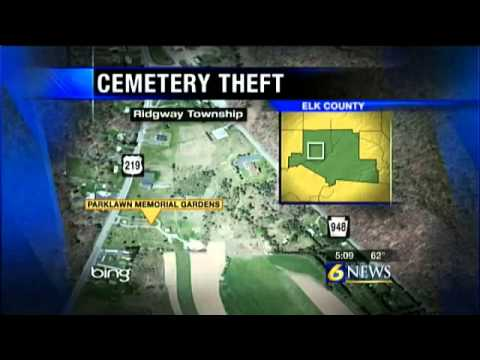 Police investigating theft of cemetery vases