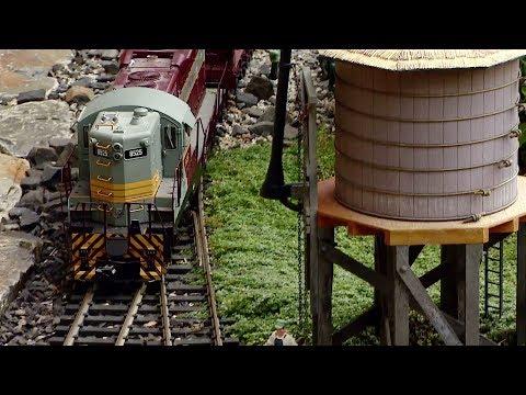 Couple Creates Tiny Model Train World In Backyard