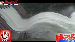 Srisailam project 7th gate lifted after flood water increase   teenmaar news