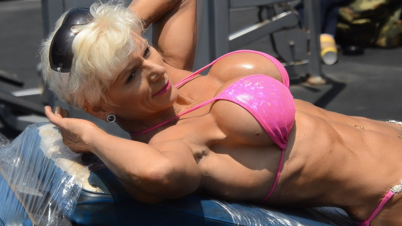 image Busty milf female bodybuilder and bald guy have group sex