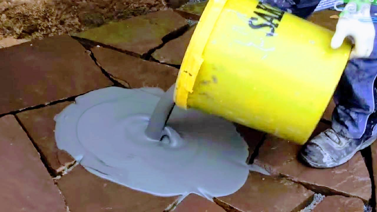how to lay grout flagstone slabs pro grouting natural stone sand joints masonry patio pavers work