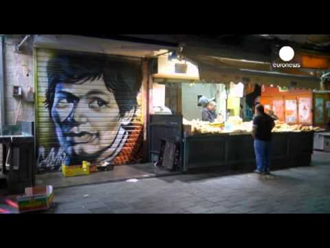 Graffiti art comes to life at night in Jerusalem market