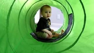 Caleb crawling through play tunnel