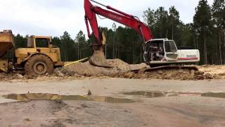 Towing the Off-Road Dump Truck with Excavator