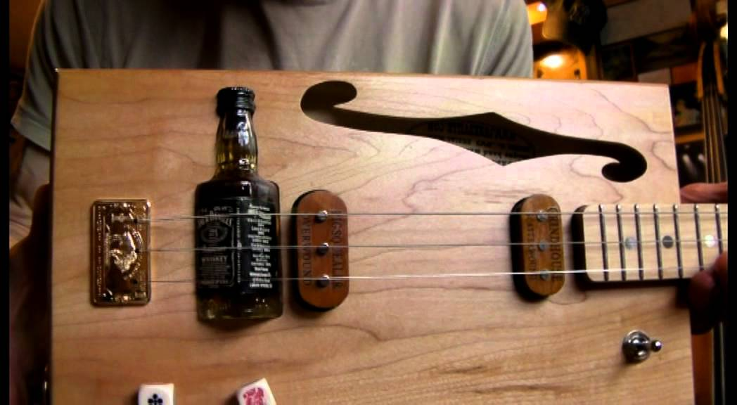 Jack daniels bottle bridge 3 string cigar box guitar by junksville