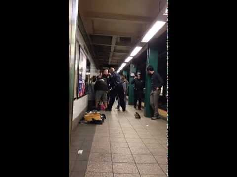 Musician arrested for singing in subway.