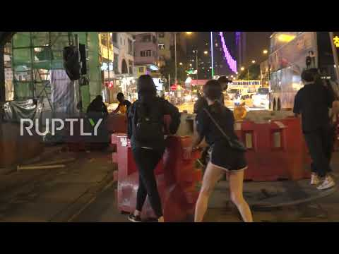Hong Kong: Protesters target surveillance cameras and MTR station