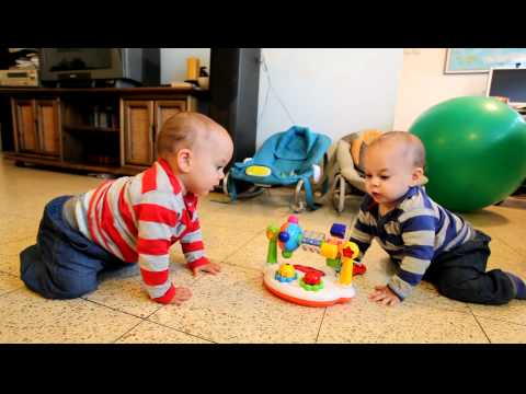9 months old twins dancing and trying to get the music back
