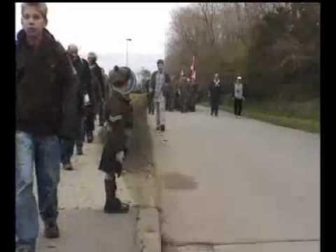 Little Belgian boy saluting Canadian Troops