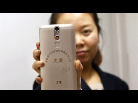 Engraving tattoo on the back of ZTE mobile phone