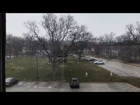 Snow falling in International Village April 2018- Schaumburg Village USA