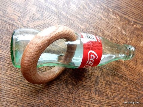 Impossible ring through glass  bottle