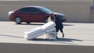 MATTRESS FALLS OFF TRUCK ON FREEWAY CAUSING AN ACCIDENT