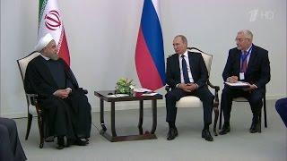Владимир Путин в Баку проводит двусторонние встречи с президентами Азербайджана и Ирана.