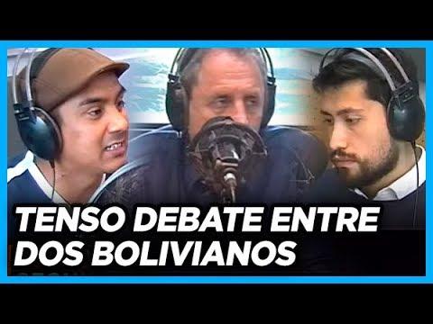 Joven boliviano a favor de EVO le pinta la cara a boliviano opositor en un tenso y polémico debate