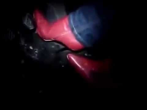 Red ankle stiletto boots with blue jeans pedal pumping