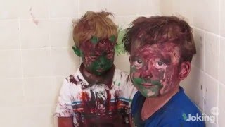 Kids are covered in paint and dad can't stop laughing