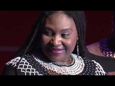 Yvonne ChakaChaka recieves a gift. Kansiime Anne. African comedy.