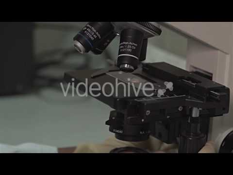 Asian Lab Tech with Microscope - Stock Footage | VideoHive 16401699