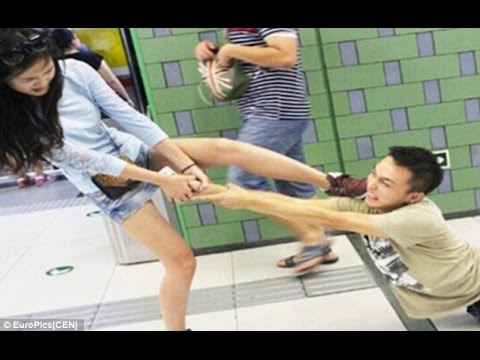 Woman Drags Phone-addicted Boyfriend Across Beijing Subway Platform