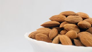 Closeup shot of rotating bowl with Indian Almonds