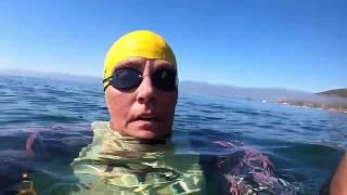 Fog lifting open water ocean swim