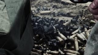 shot of a belt fed machine gun as it is fired