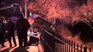Accident at Great Falls Paterson NJ. A mini van crashes thru a iron fence, down an embankment.
