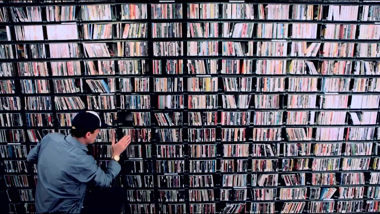 This is an image of videos on shelves at a library.
