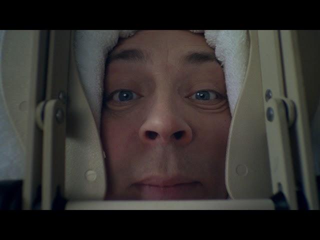 Interoptikeren stiv nakke - reklamefilm