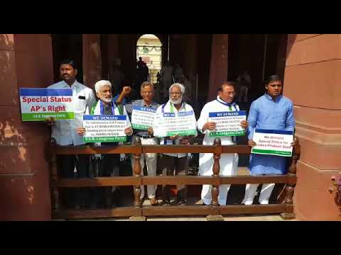 YSRCP MPs continued their protest at the entrance of Parliament House