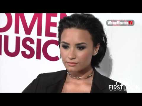 Demi Lovato on the red carpet at the 2015 Billboard Magazine Women in Music Lunch