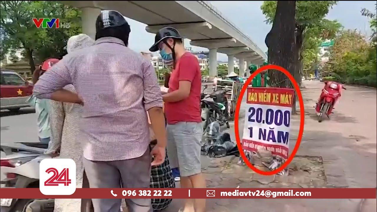 Trục lợi từ việc người dân đổ xô đi mua bảo hiểm xe máy   VTV24