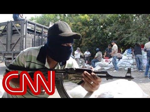 Vigilantes seize drug lord's mansion