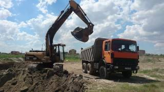 CATERPILLAR EXCAVATOR, heavy equipment in action Loading DAF and MAN  Trucks