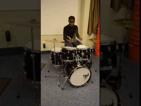 Overbrook School for the Blind student plays drum set from Gift of Music