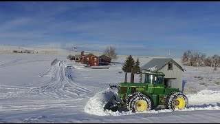 John Deere 8440 plowing snow in Bickleton, WA. DJI Phantom 3 standard drone and a go pro camera