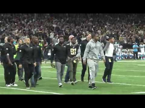 Reggie Bush leads Saints onto field, wears Will Smith jersey for 'Who Dat' chant