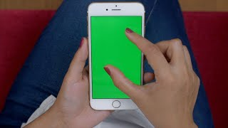 Shot of a woman using her smartphone (Scroll, Zoom, Pinch) with the green screen