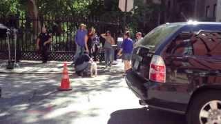 Matt Bomer petting a dog August 14, 2013