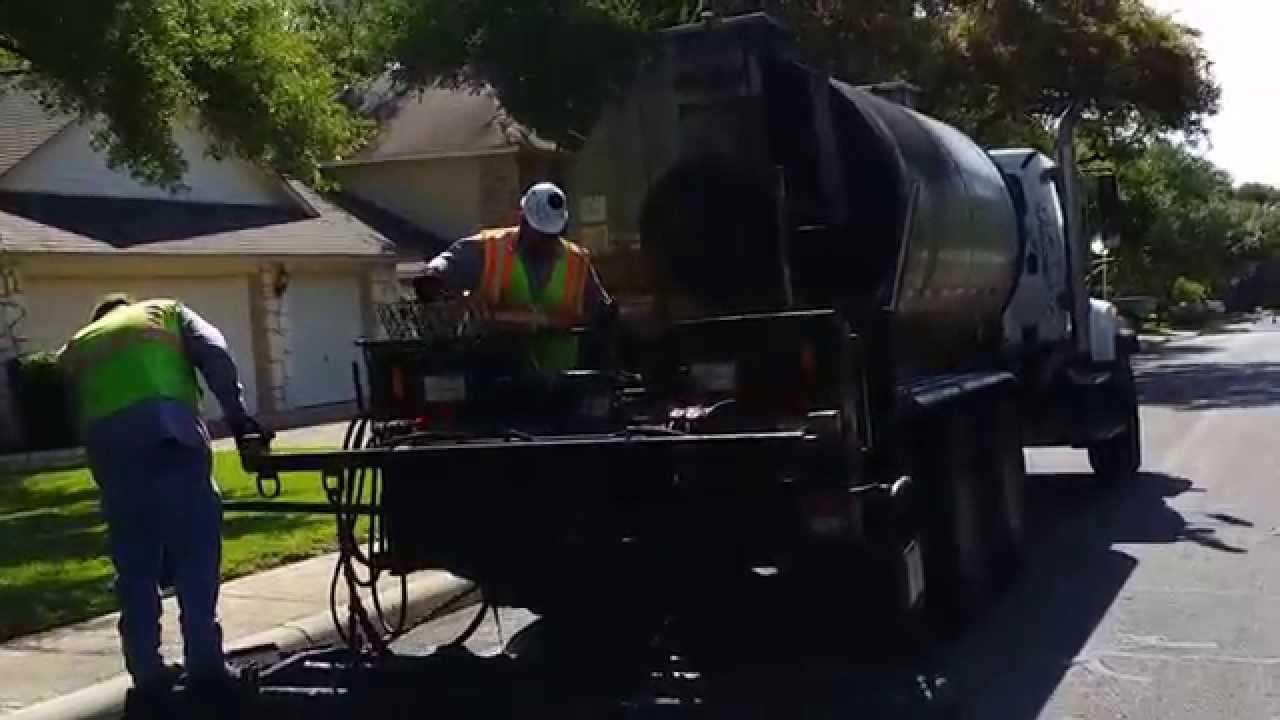 Pitch Black Asphalt Emulsion Pavement Sealer Lied On San Antonio City Street You