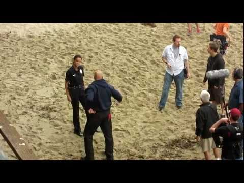Video of pre-filming/set-up with Ana Alexander in a scene for Chemistry; Alexander plays the role of a sexy cop and she is preparing to chase and take-down a thug by the pier in Redondo Beach, California