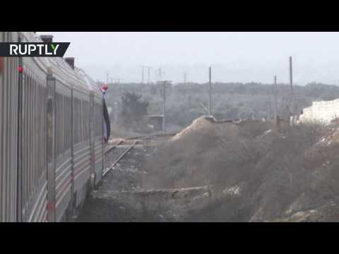 Syrians seen smiling and excited as train travels through Al