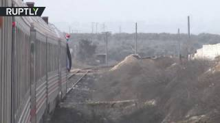 Syrians seen smiling and excited as train travels through Aleppo for first time in over four years