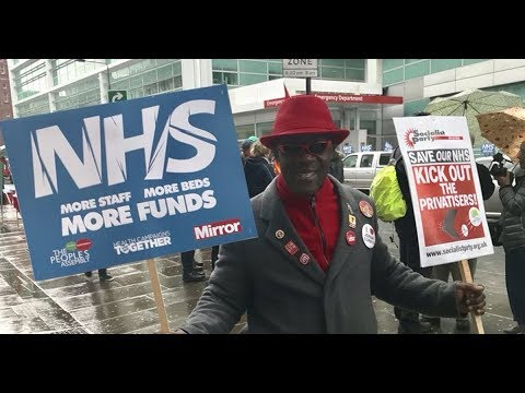 Tens of thousands march in London to 'Fix the NHS' and demand government deal with health