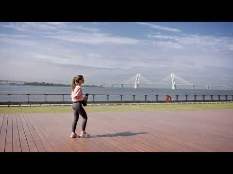 woman-walking-on-the-seaport-with-yoga-mat-and-drinking-water-[no-copyright-videos]-(full-hd)