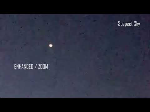 Large UFO with Smaller Components Nearby [SIGHTING]