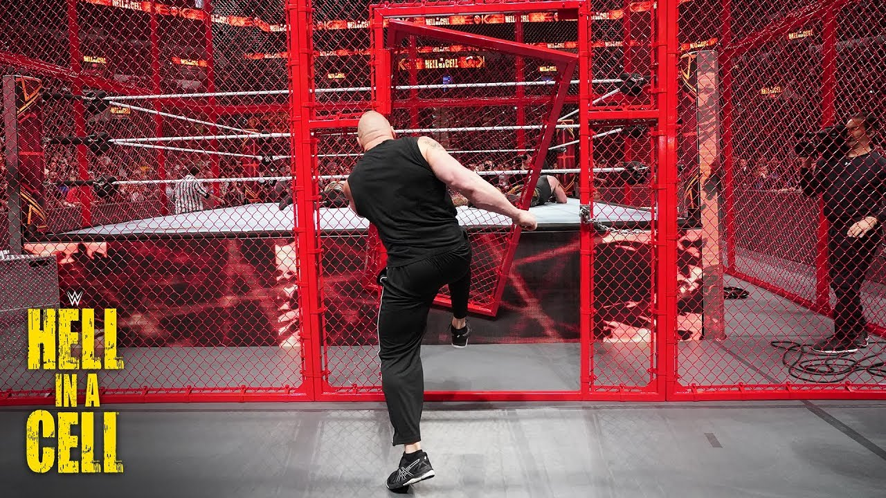 Brock Lesnar Kicks The Hell In A Cell Door Off Its Hinges