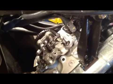 how to adjust manual cam chain tensioner