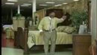 Funny guy doing a rap commercial for his furniture store